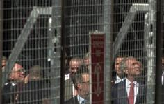 andrew-meares-howard-and-bush-behind-the-cage.jpg