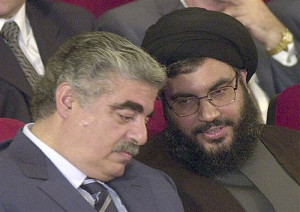 May 25, 2001 Former Lebanese Prime Minister Rafik Hariri, left, talks with Hezbollah leader Sheik Hassan Nasrallah, right, during an official ceremony to mark the first anniversary of the Israeli withdrawal from south Lebanon, in Beirut, Lebanon. Credit: Mahmoud Tawil