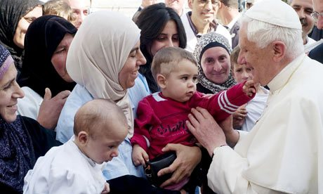 Pope Benedict XVI meeting Palestinians at the maternity hospital run by the Catholic charity Caritas in Bethlehem. Photograph: Peter Dammann/AFP/Getty Images